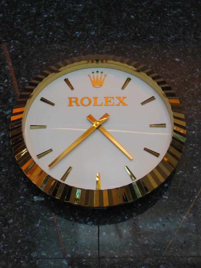 horloge murale publicitaire rolex. Black Bedroom Furniture Sets. Home Design Ideas